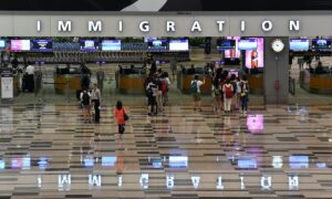 Singapore will track travelers with electronic devices to make sure they're quarantining